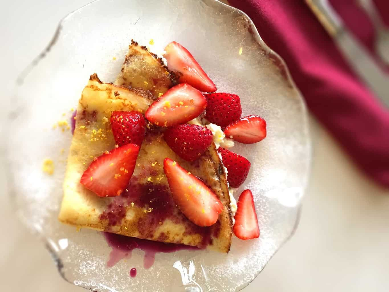 Creamy and tender strawberry and ricotta crepes. Perfect treat for satisfying your sweet tooth.