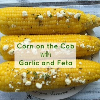 Simple and mouthwatering corn on the cob, brushed with garlicy butter and sprinkled with feta cheese crumbles.