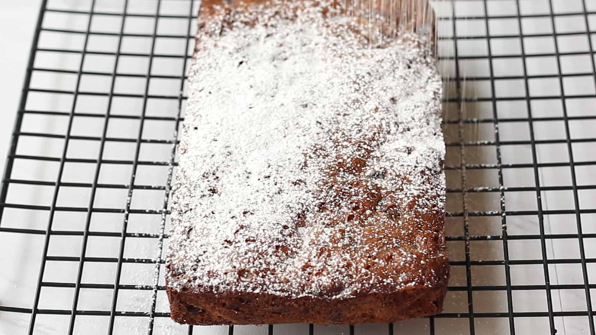 Sprinkling the loaf with powdered sugar