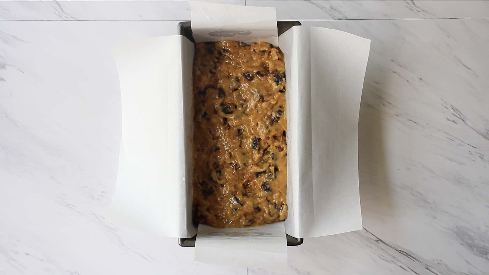 Dried fruit batter in a loaf pan
