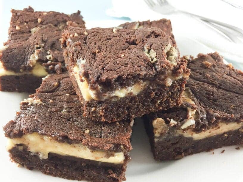 Absolutely YUMMY! Satisfy your chocolate craving with this Easy Brownie Recipe With Mascarpone Swirl. It's an ooey-gooey deliciousness, that slowly melts in your mouth. Crispy on the outside and moist and fluffy on the inside. #brownies #brownierecipe #easybrownierecipe