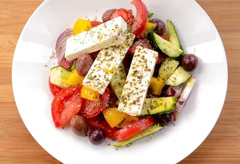 Roughly chopped up veggies and a delicious creamy feta cheese are combined to create a perfect fresh and vibrant shepherd salad that tastes delectable.