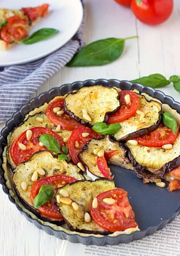 Perfectly moist, flavorful, filled with roasted veggies and cheese, this Eggplant Tart With Tomatoes And Goat Cheese is such a delicious holiday treat!