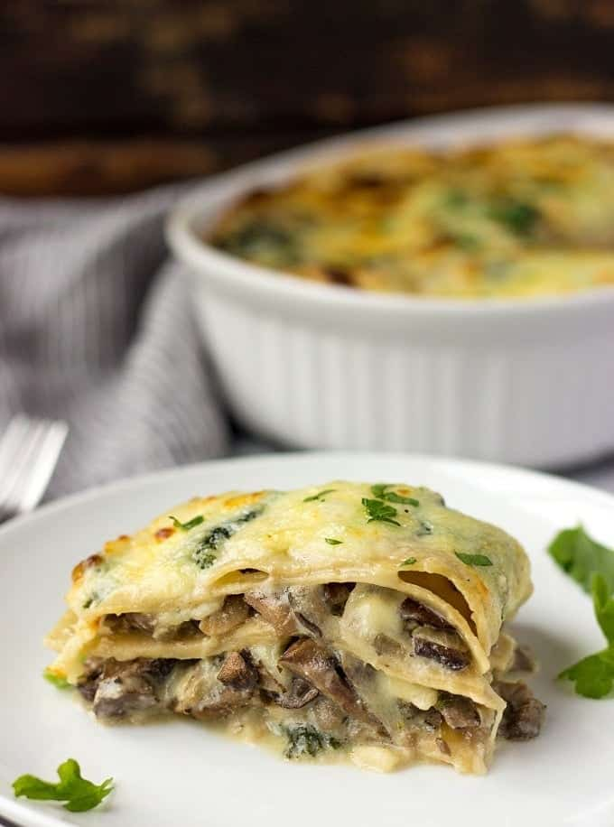 You'll fall in love with mushrooms! This Creamy Kale And Mushroom Lasagna is full of delicious and aromatic mushrooms, covered in a cheesy Bechamel sauce and fresh Mozzarella and baked until bubbly perfection.