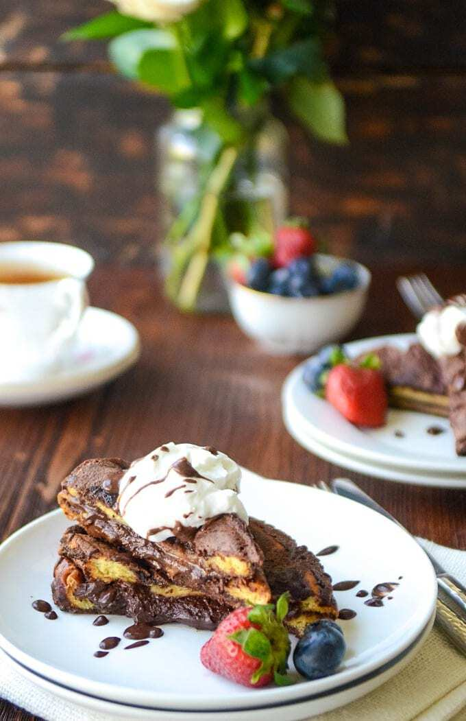 This Stuffed French Toast is a bomb. Loaded with ooey-gooey chocolate and warm and comforting flavors, this Easy French Toast Recipe is sure to become your favorite breakfast!