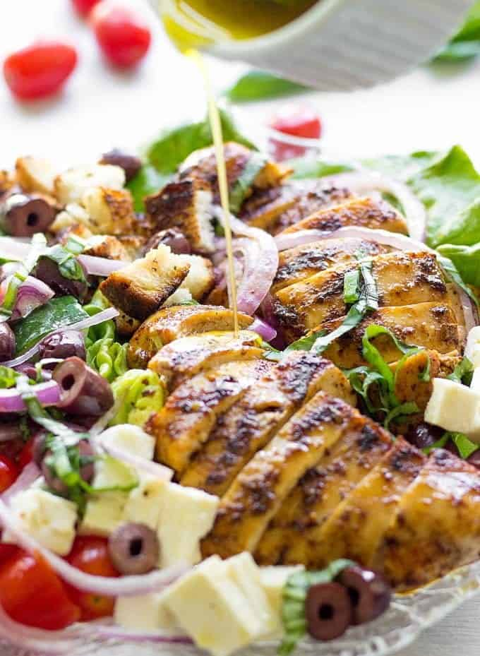 Herb-smothered grilled chicken, fresh veggies and crunchy croutons produce an epic Grilled Chicken Greek Panzanella Salad. It's a feel good summer recipe your family will love! If you're looking for a new twist on classic Greek Salad, give this Grilled Panzanella a try!