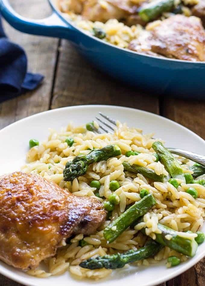 Loaded with comforting flavors, this One Pot Chicken & Vegetable Orzo Risotto is a delicious weeknight meal your family will thank you for!