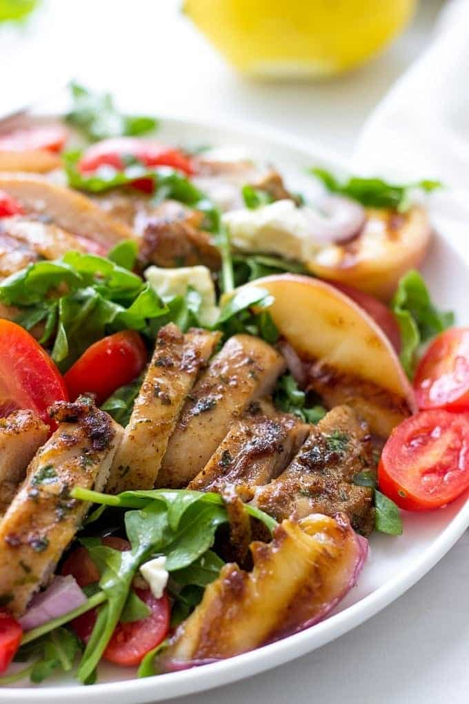 EPIC Portuguese Salad With Grilled Chicken And Peaches is such a healthy summer recipe! Chicken is marinated in a secret combination of spices and grilled to perfection. This juicy salad makes an easy weeknight recipe!