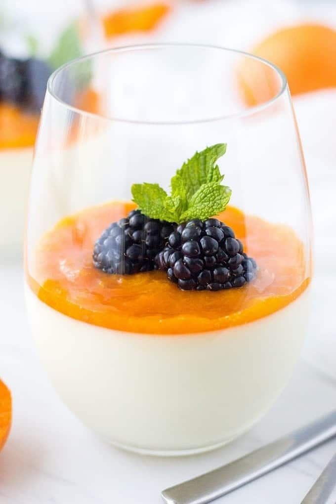 This Easy Panna Cotta Recipe is a BOMB! Topped with a delicious Apricot Compote, this simple Italian dessert is absolutely mouthwatering. This can be a great dessert for a crowd too.