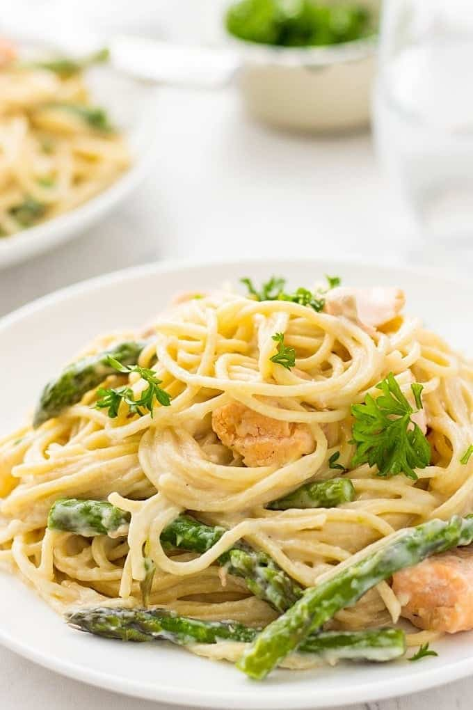 Looking for easy dinner recipes? This CREAMY SALMON PASTA WITH ASPARAGUS is packed with comforting flavor. Easy to make and so delicious!