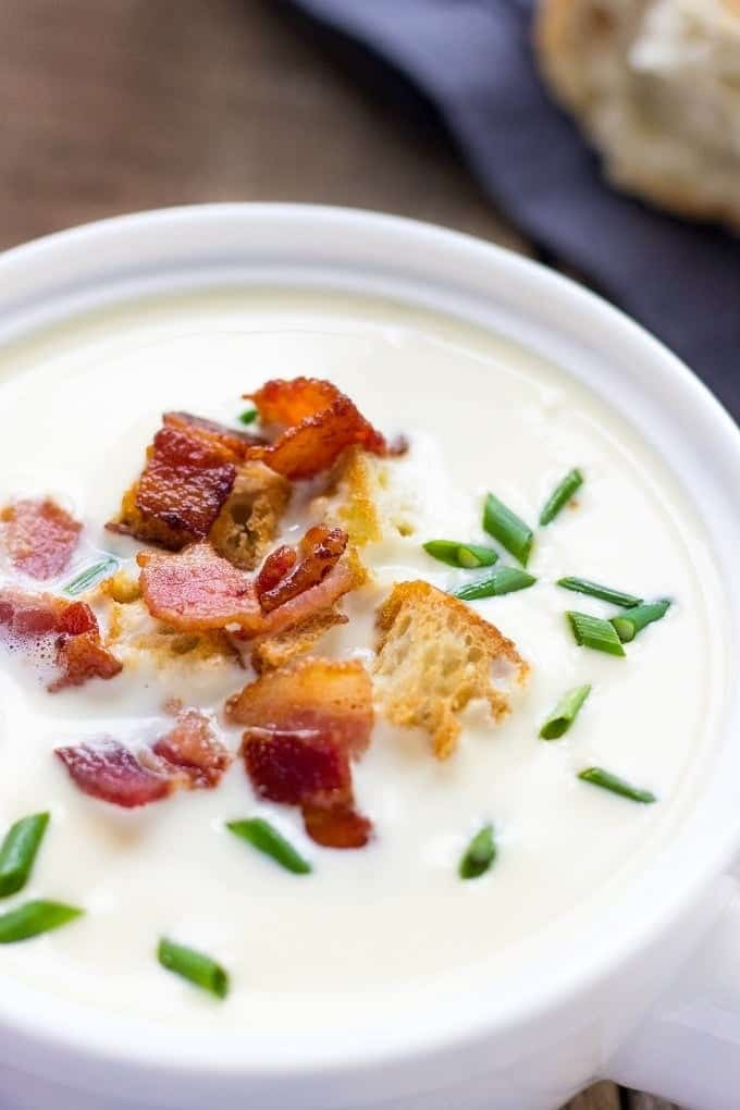Are you looking for gourmet comfort food recipes? Prepare to fall madly in love with an incredible flavor and taste of French Parmesan Soup with Crispy Bacon And Garlicky Croutons. Try it once and you'll be hooked. Make it without croutons and you have a comfort food low-carb and keto soup recipe.