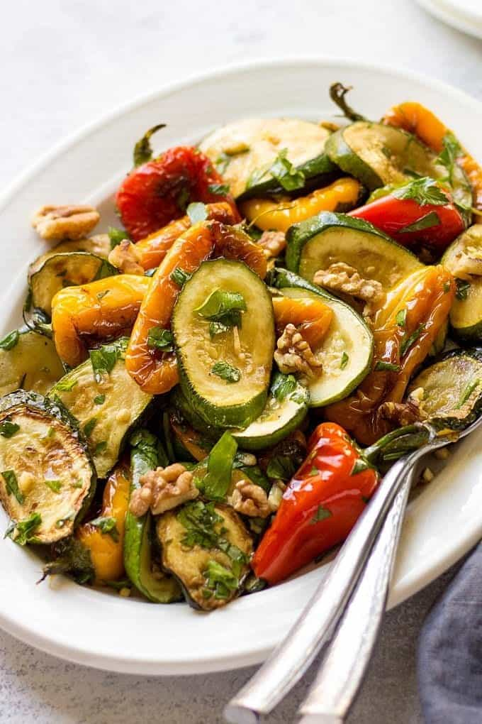 Georgian Salad With Baby Sweet Peppers And Zucchini served on the white oval platter. Image for Pinterest