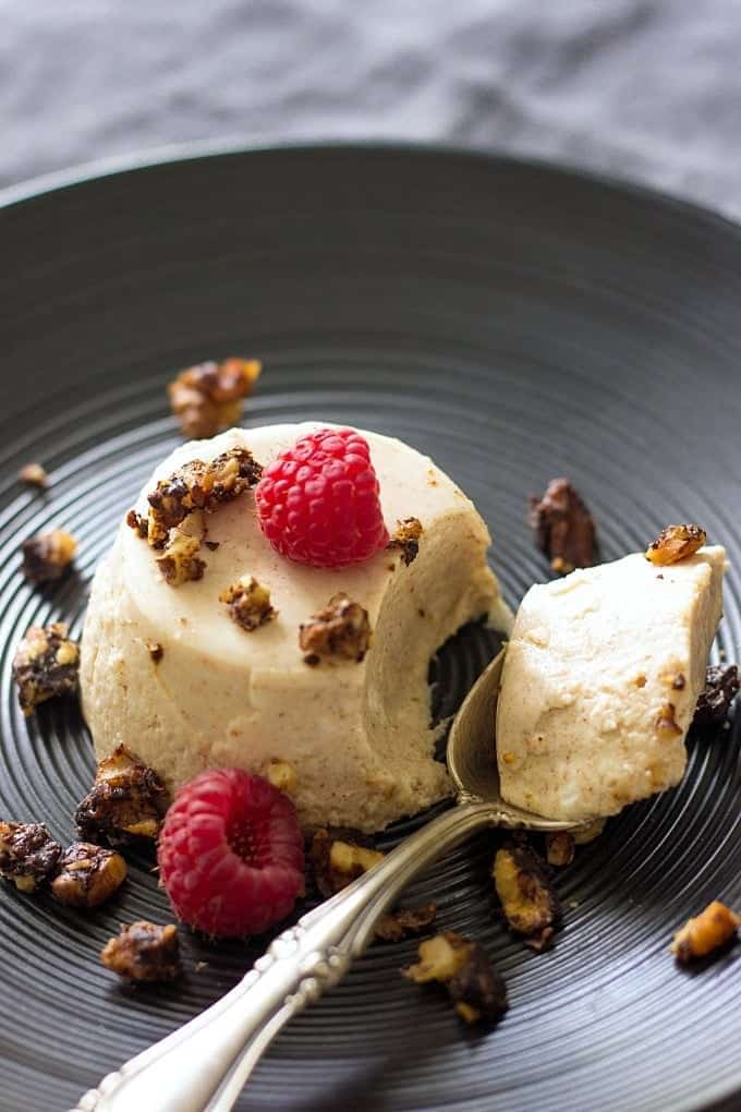 Almond Butter Yoghurt Panna Cotta on a black plate