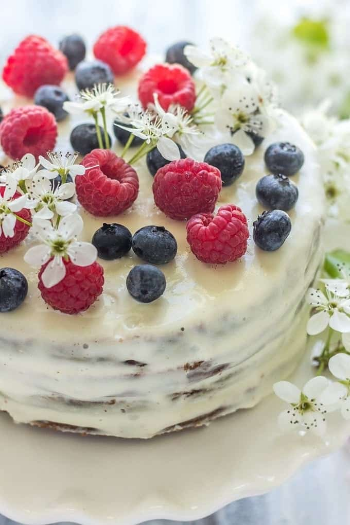 Vanilla Sour Cream Cake topped with fresh berries
