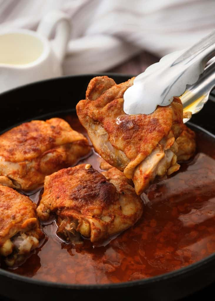 Cooking Chicken Paprikash in a chicken broth