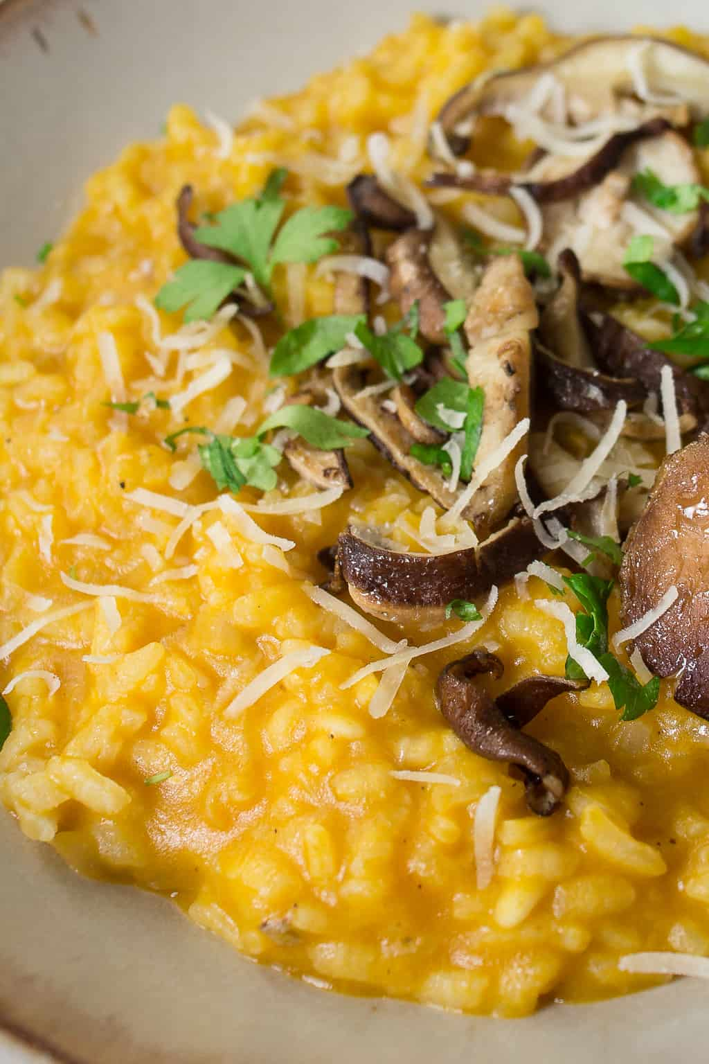 Risotto made with canned pumpkin puree and Shiitake mushrooms sprinkled with Parmesan cheese