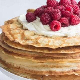 Raspberry Crepe Cake on a cake stand