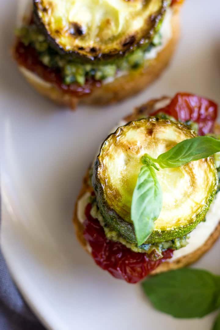 Overhead photo of Bruschetta with cream cheese, sun-dried tomatoes and zucchini