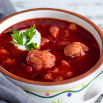 Vegetarian Borscht in a bowl with a dollop of sour cream