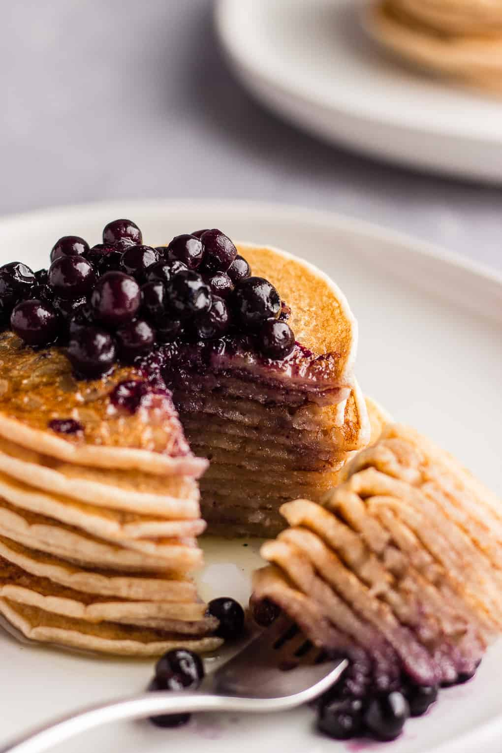 Slice of pancakes with blueberries