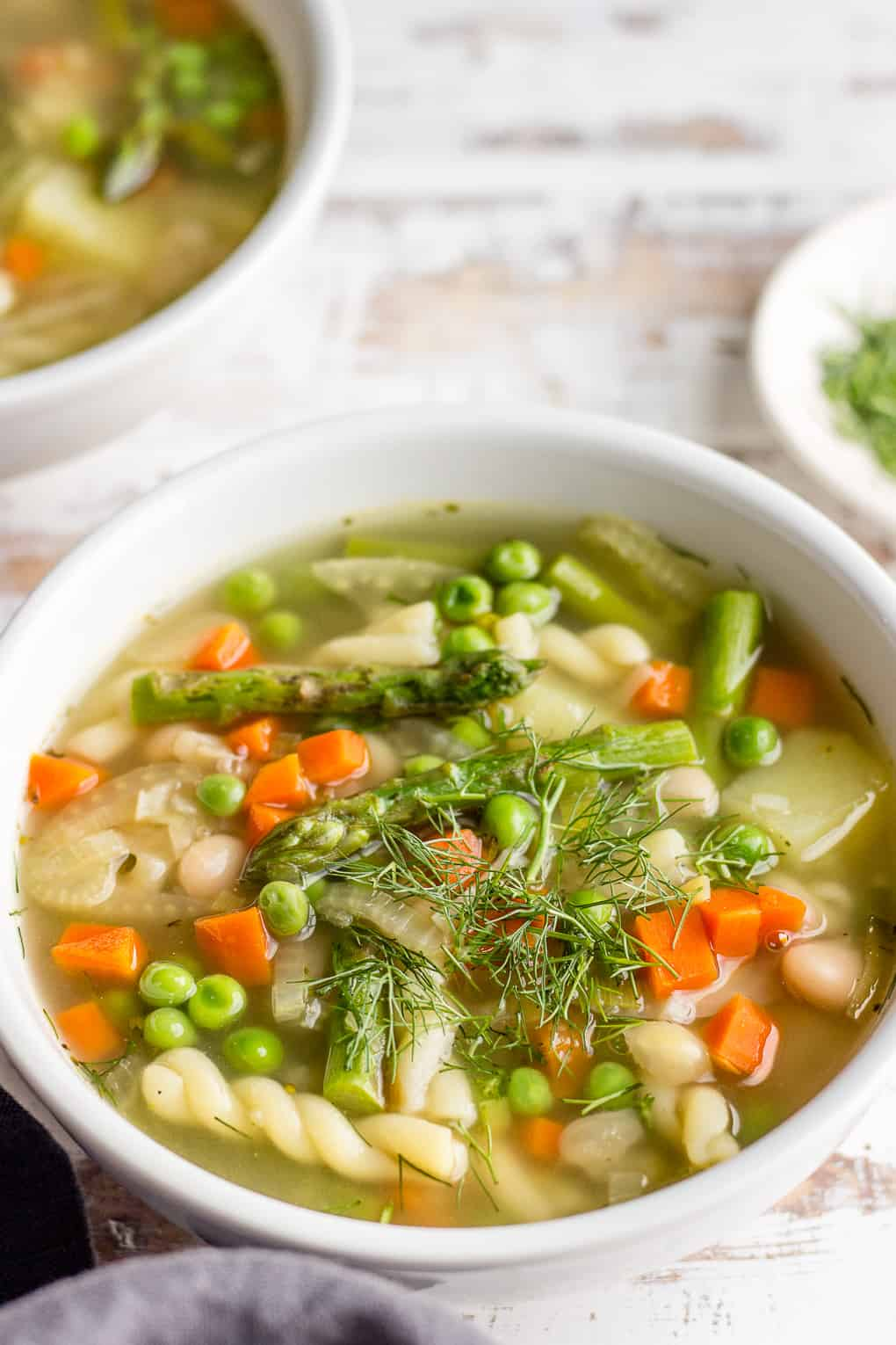Soup with asparagus, green peas and pasta