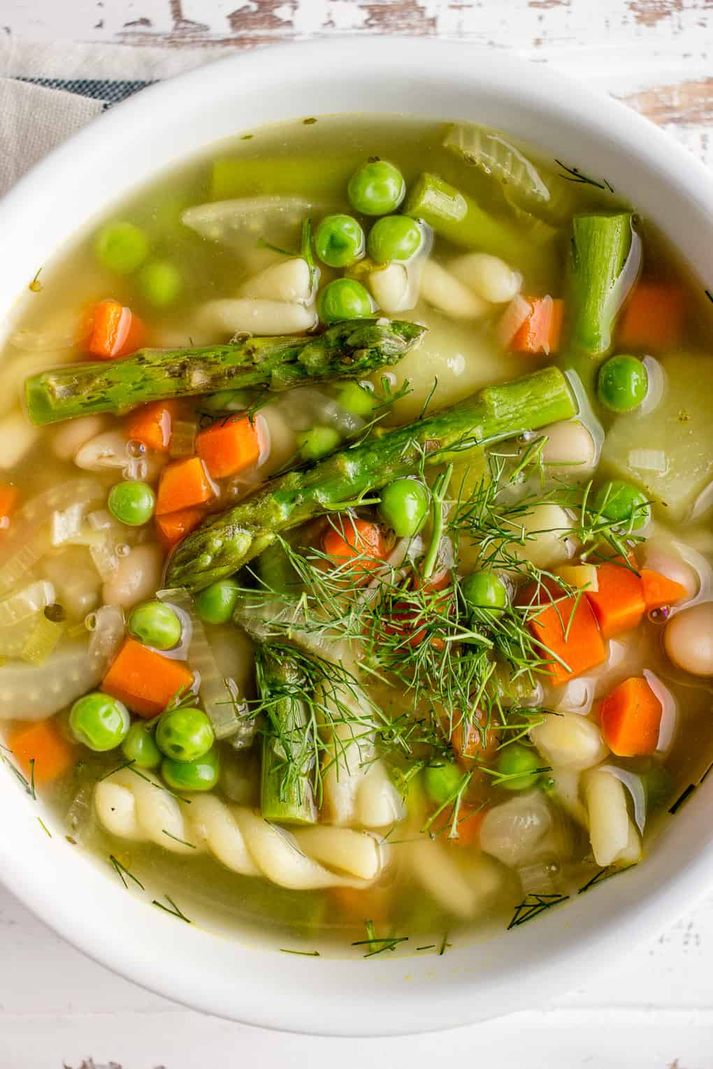 Spring Soup with asparagus, green peas and pasta
