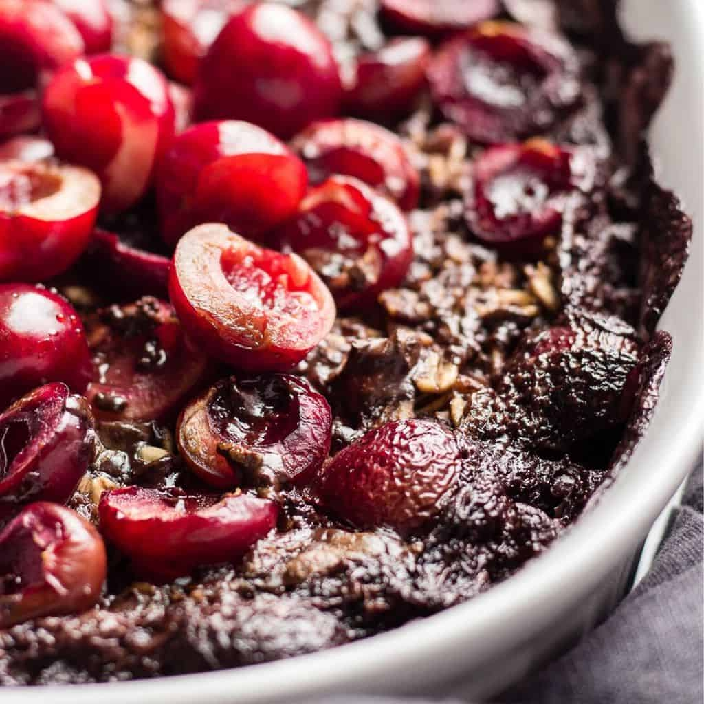 Chocolate Baked Oatmeal topped with fresh cherries