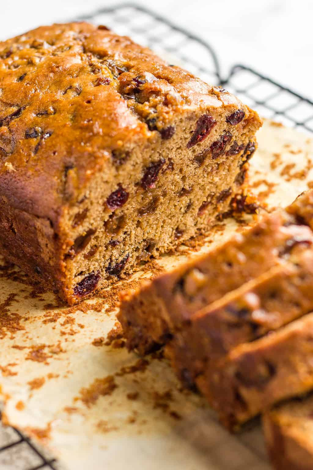 British fruit loaf on a cooling rack against white background