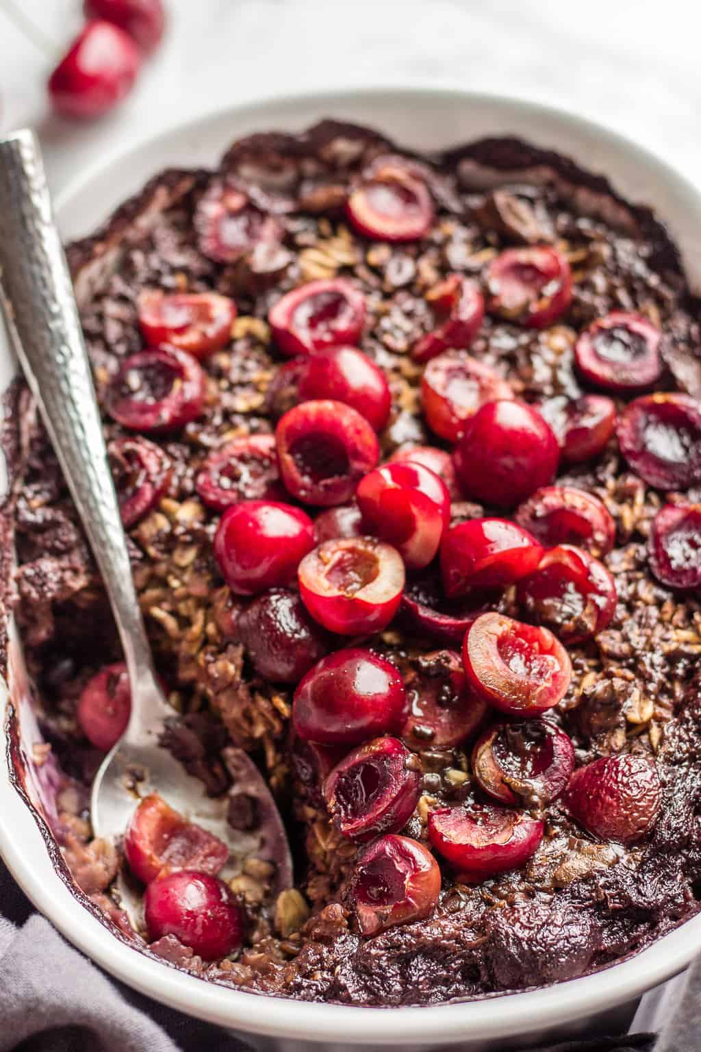 Fresh cherries topped baked chocolate oatmeal