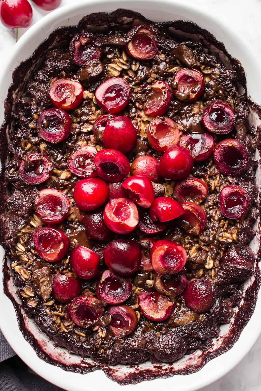 Overhead picture of chocolate baked oatmeal topped with cherries