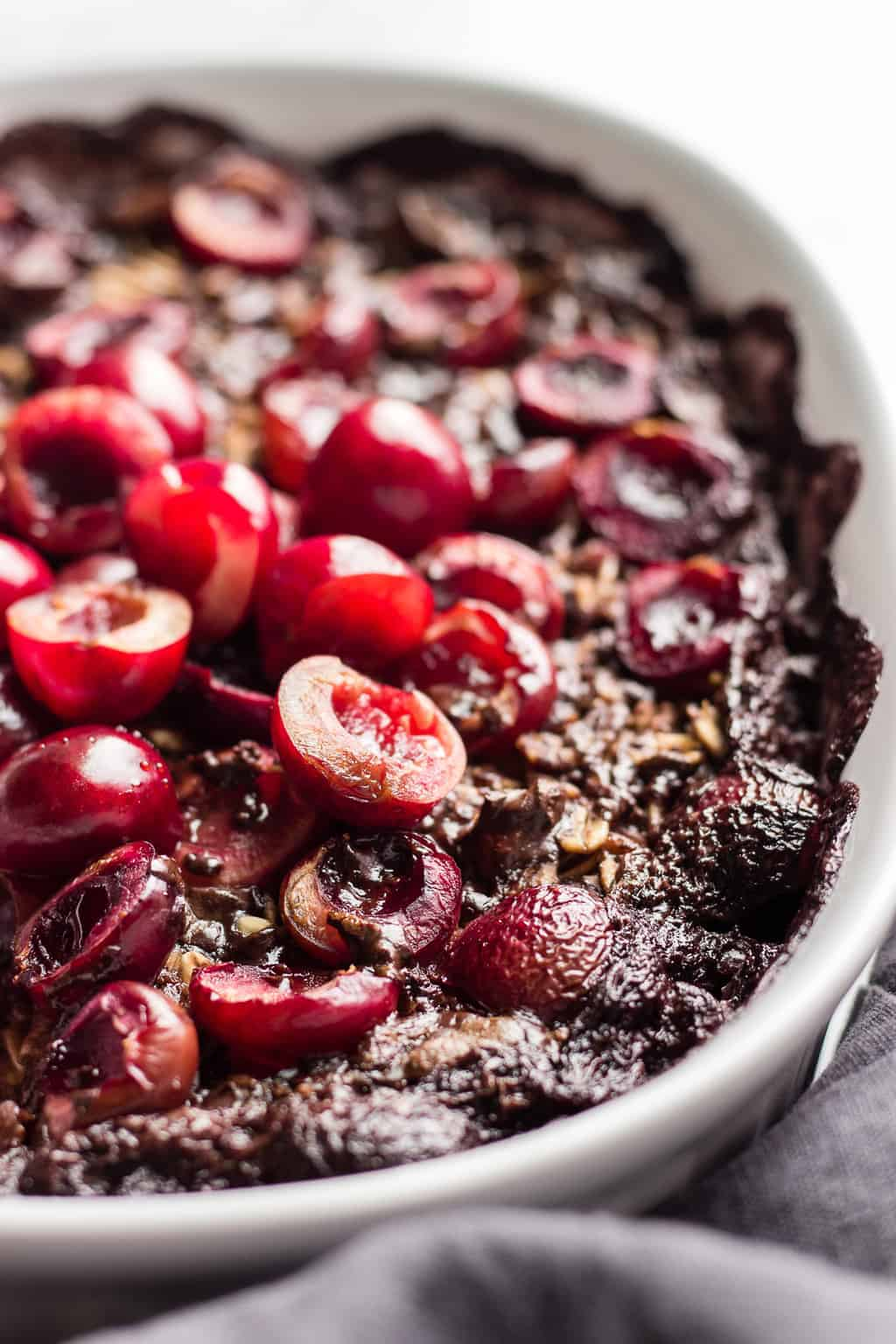 Baked vegan oatmeal with cacao, chocolate and fresh cherries