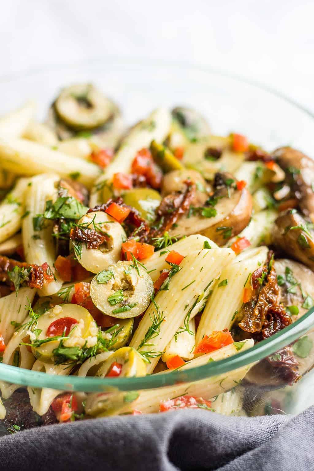 Glass bowl with healthy mushroom pasta salad