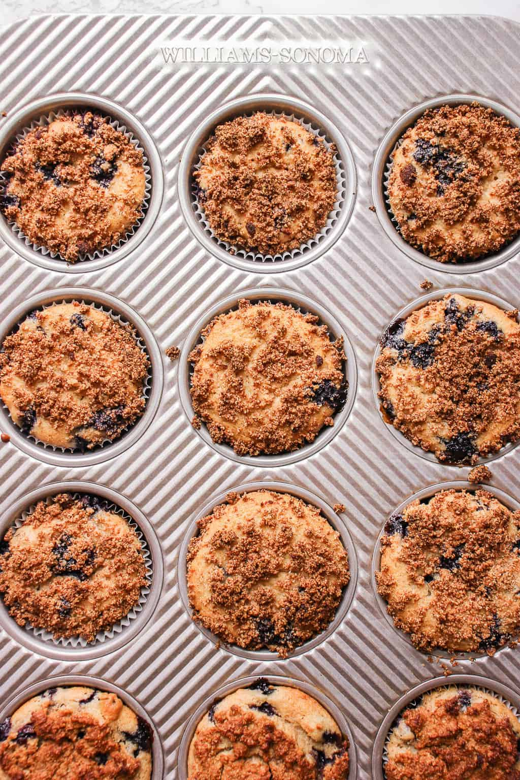 Healthy muffins with blueberries in a muffin pan