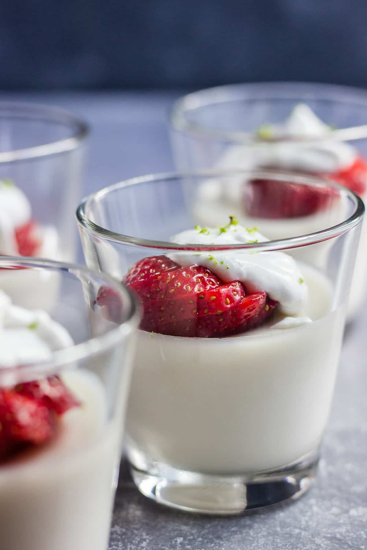 Vegan Posset in glasses garnished with strawberries