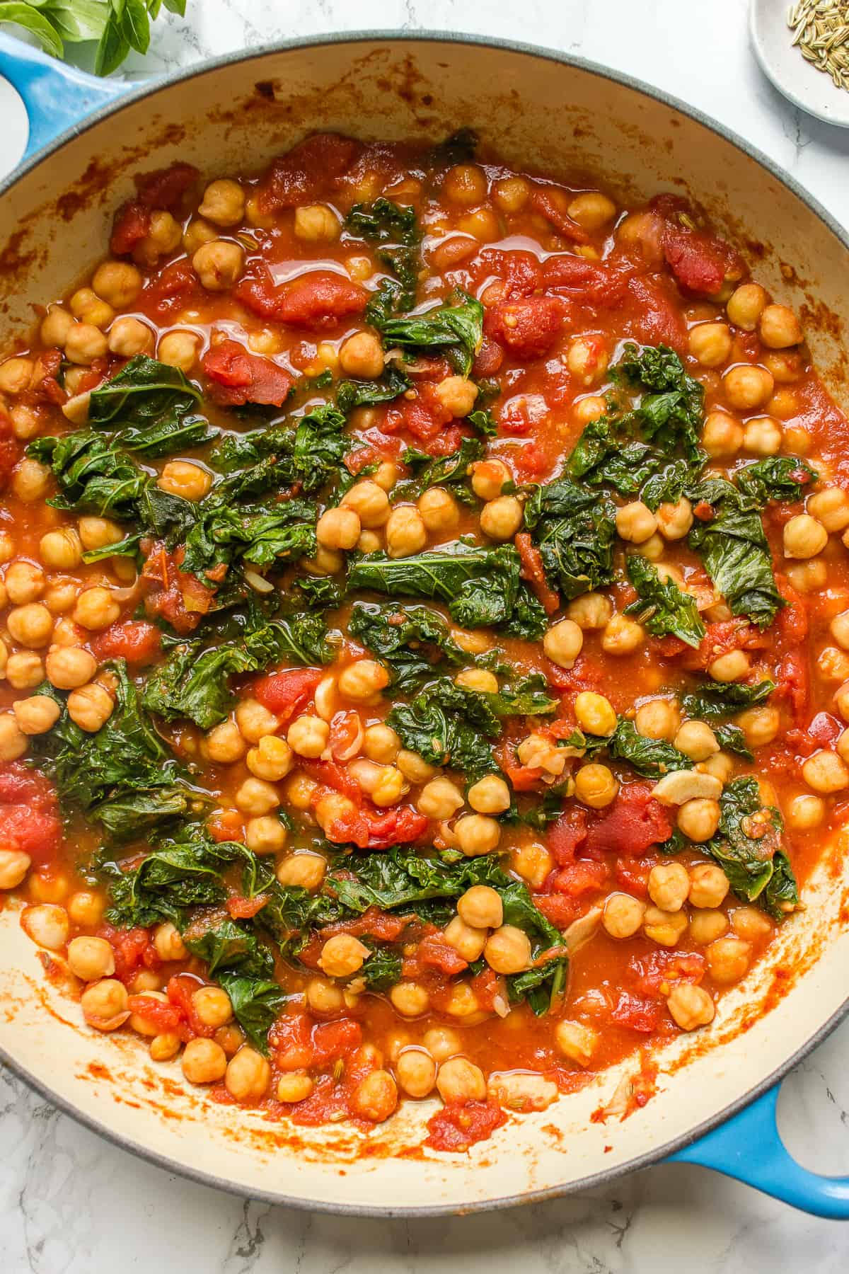 Overhead of garbanzo bean and kale stew