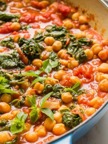 Garbanzo bean and kale stew in a pan