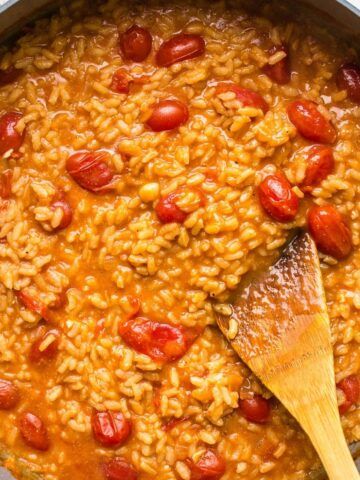 tomato risotto in a pan on a white table