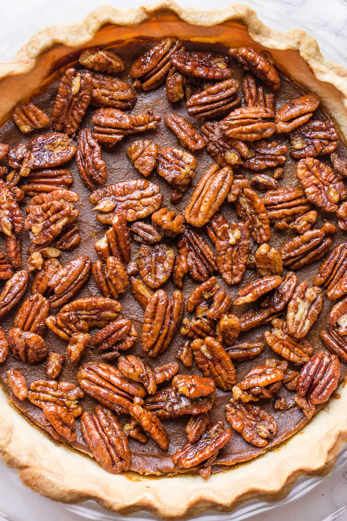 Egg-Free Pumpkin Pie topped with pecans
