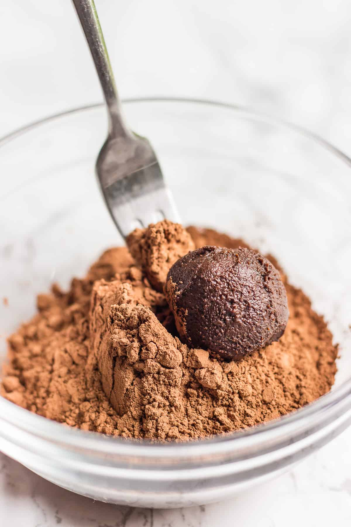 Coating avocado truffles in cacao powder