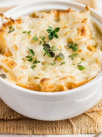 Vegan French Onion Soup with toasted baguette and cheese