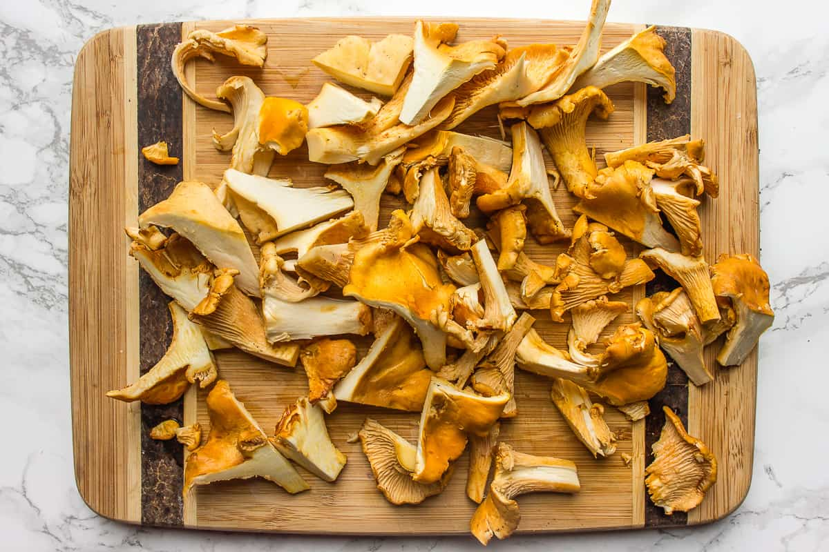 Chopped chanterelle mushrooms on a cutting board