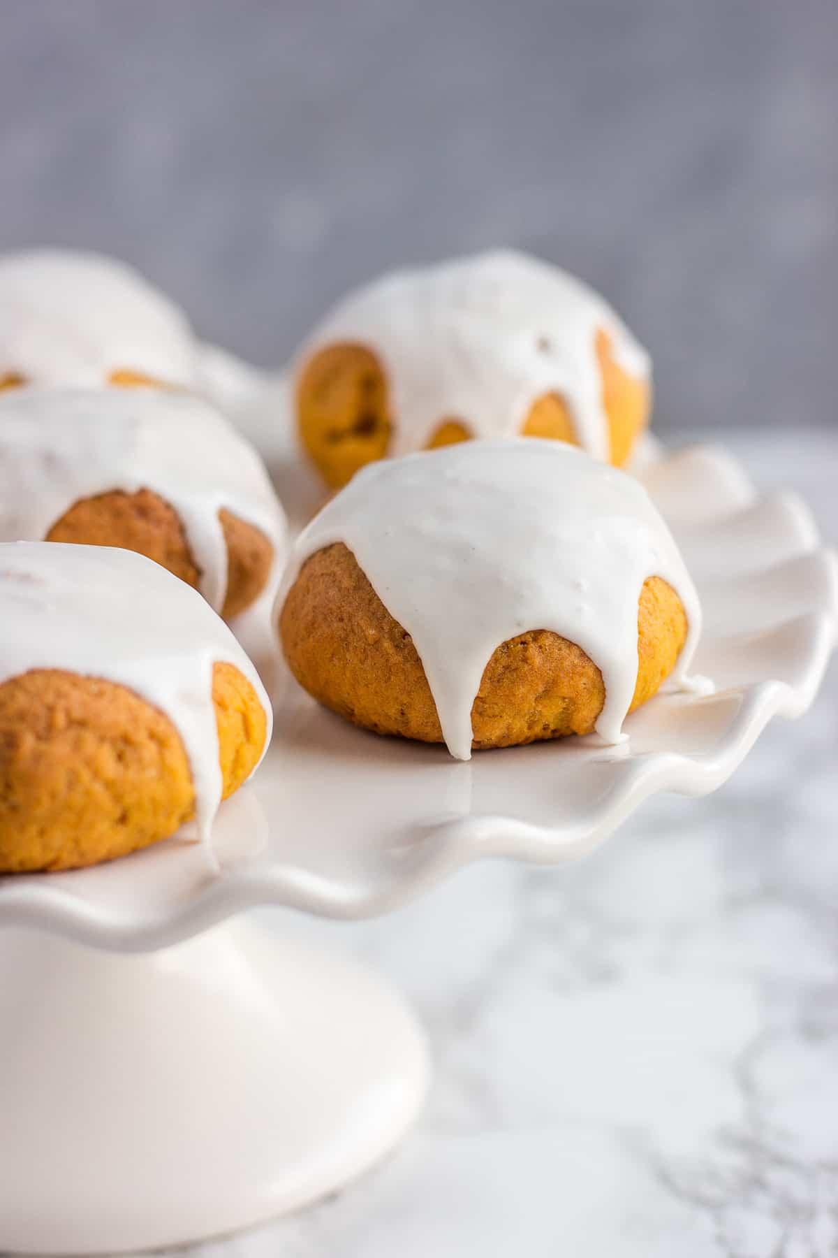Soft Pumpkin sugar cookies on a cake stand
