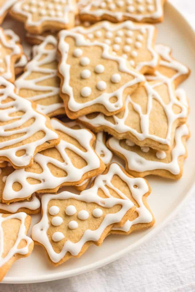 A close-up shot of vegan ginger spice cookies decorated like Christmas trees