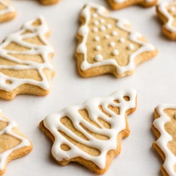 Vegan ginger spice cookies decorated like Christmas trees