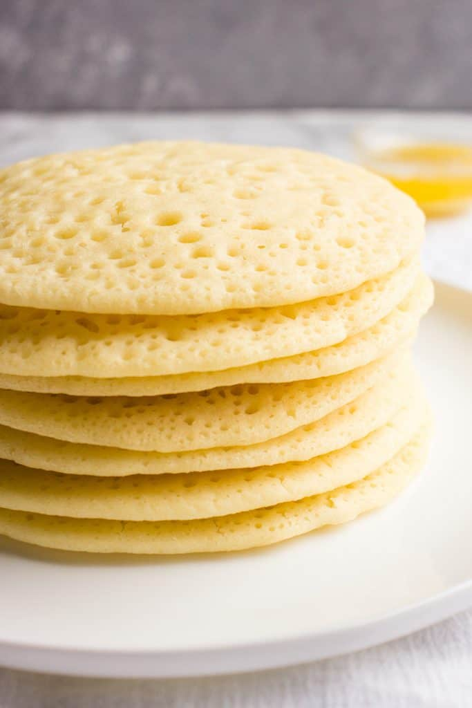 Lacy yeast pancakes on a plate