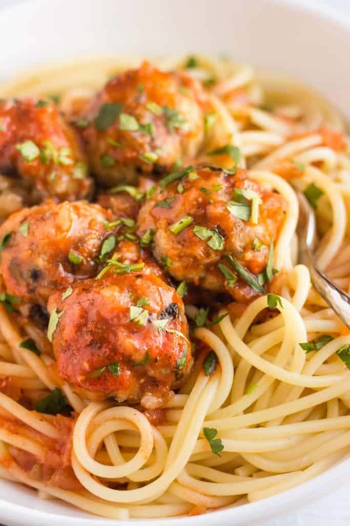 Rice and mushroom meatballs on a bed of spaghetti