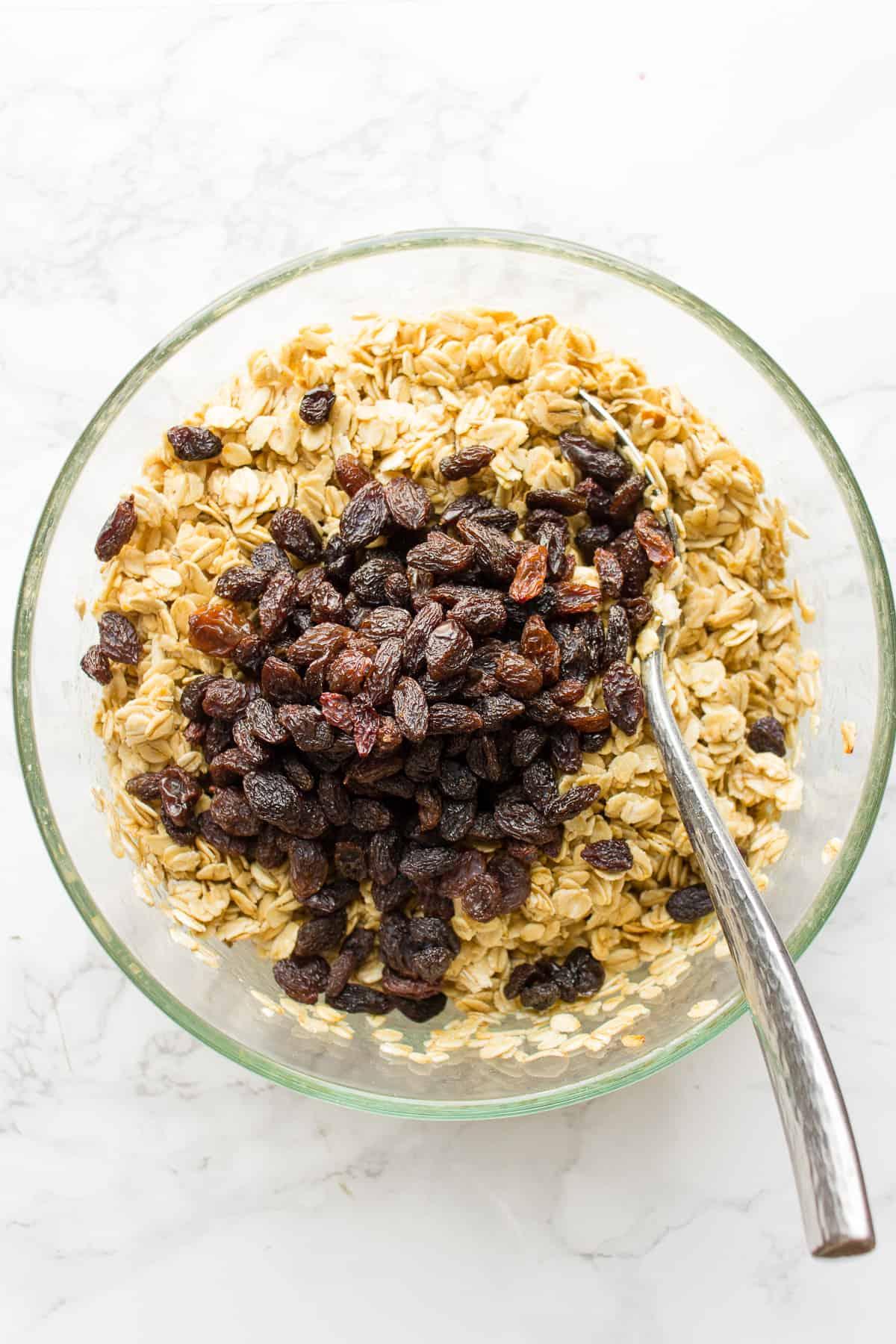 Stirring raisins into simple granola
