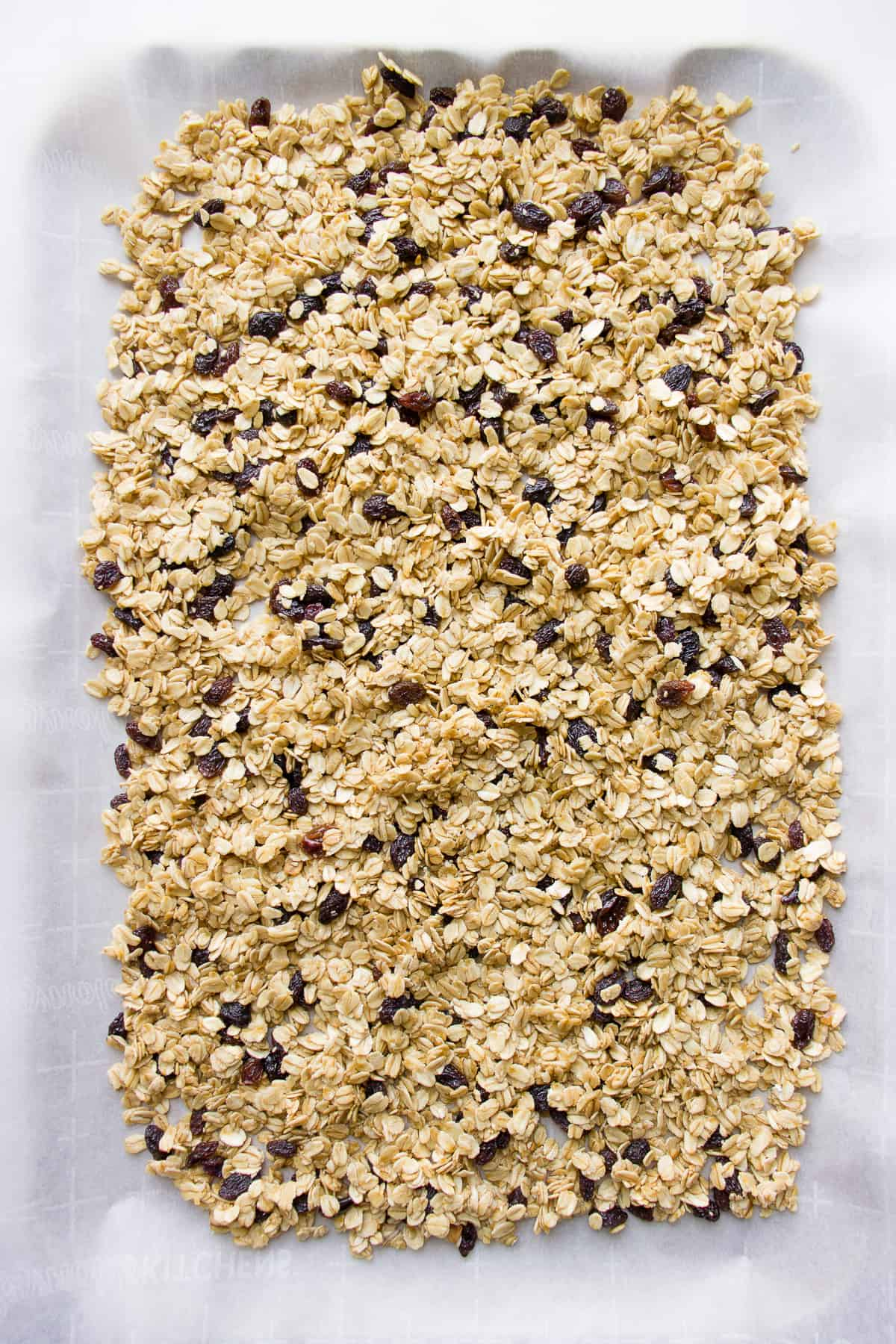 Simple granola recipe spread out on a baking tray