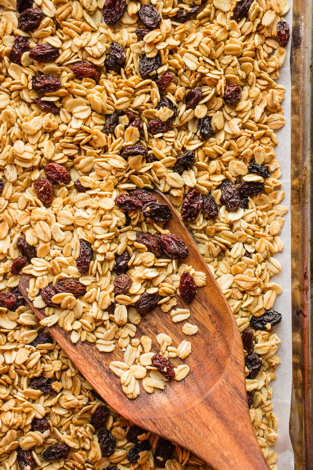 A wooden spoon full of granola