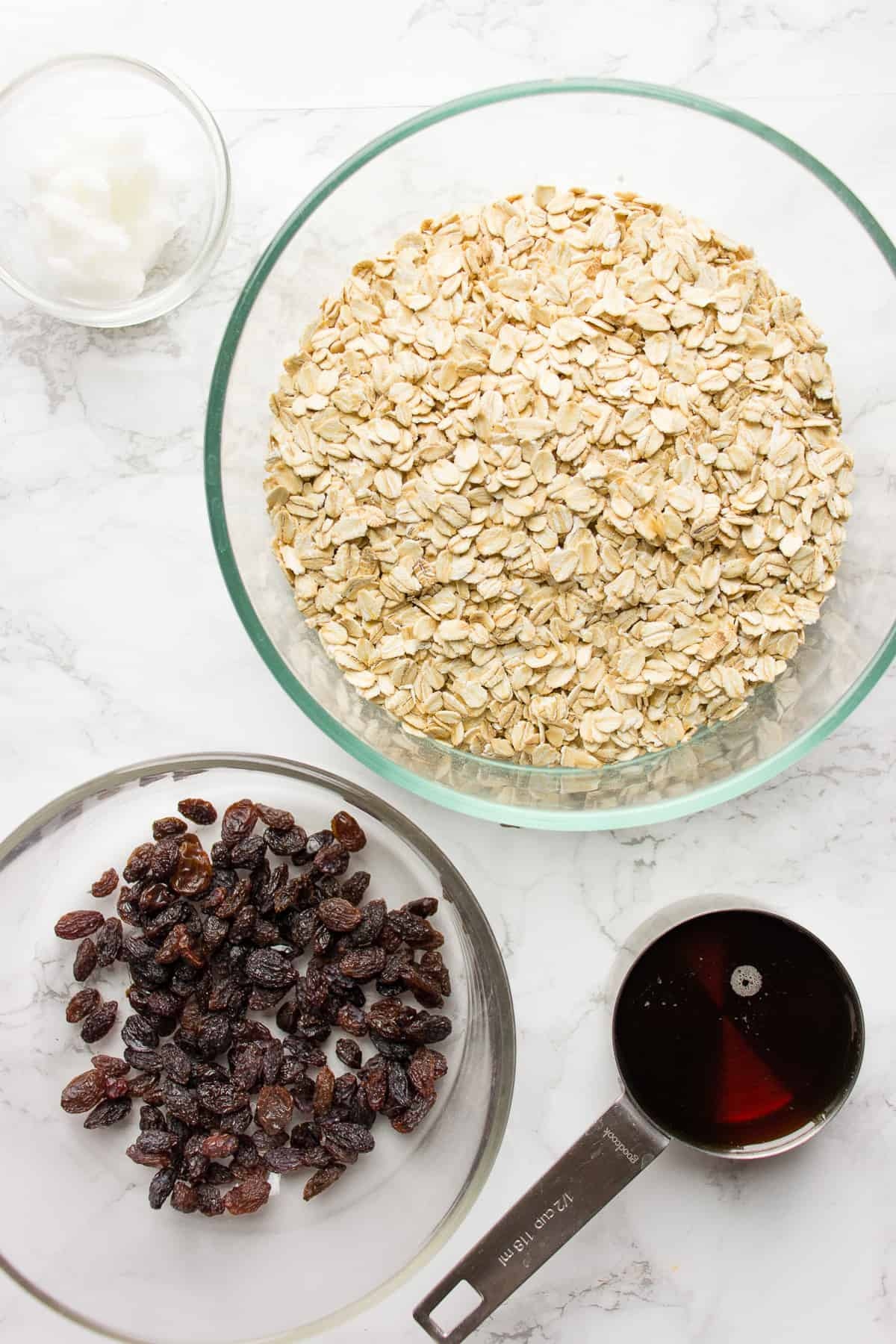 Ingredients for simple granola in glass bowls on a counter